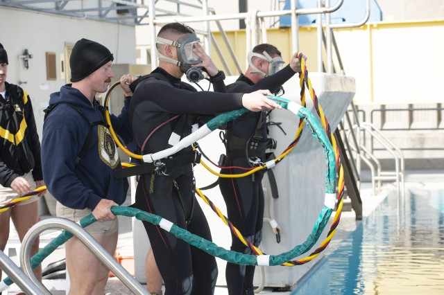 Divers check oxygen wires the colors match with the appropriate diver. If they do not match, it could have fatal consequences for a teammate.