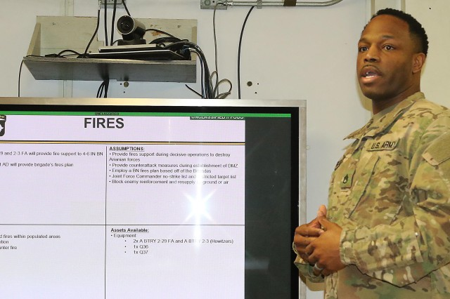 Staff Sgt. James Cherry gives his presentation on a fictitious operation Feb. 12, the night prior to graduation. Cherry was instrumental in getting approval and ensuring everything was done to facilitate the course at Bagram Airfield, Afghanistan. Cherry learned he was going to the course five days before it began as a reward for all his hard work in setting up the course at BAF. (Photo by Jon Micheal Connor, Army Public Affairs)