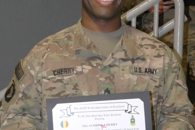 Staff Sgt. James Cherry proudly displays his Battle Staff NCO Course graduation certificate during the graduation ceremony Feb. 13. Cherry was instrumental in getting approval and ensuring everything was done to facilitate the course at Bagram Airfield, Afghanistan. (Photo Jon Micheal Connor, Army Public Affairs)