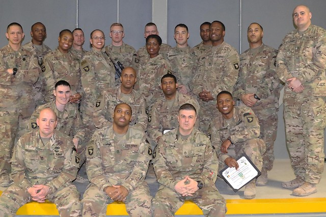 All 16 graduates of the Battle Staff NCO Course class 05-19 gather with assistant instructors following the graduation ceremony at Bagram Airfield, Afghanistan. (Photo Jon Micheal Connor, Army Public Affairs)
