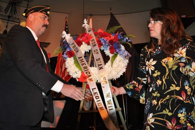 "Jere Romano, post commander of the American Legion No. 283, Pacific Palisades, California, left, along with his wife, Martha, place a wreath by a cement plaque of Marvel Comic book creator Stan Lee's signature during ""Excelsior! A Celebration of the Amazing, Fantastic, Incredible and Uncanny Life of Stan Lee"" Jan. 30 at the TCL Chinese Theatre in Hollywood, Calif. The event was a memorial tribute to Lee, Marvel comic book writer, editor, publisher and co-creator, who died in November 2018. Lee was an Army veteran and former writer in the U.S. Army Signal Corps during World War II."
