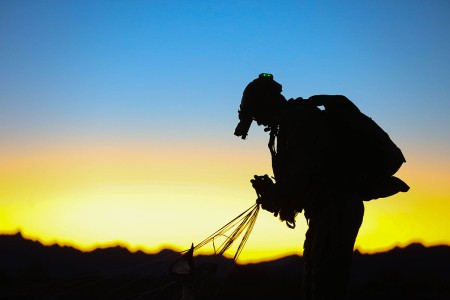A U.S. Army Special Forces Soldier with 1st Special Forces Group (Airborne) begins to pack his parachute after a night high altitude high opening jump Jan. 25, 2019, during a three week training exercise at Yuma, Ariz.