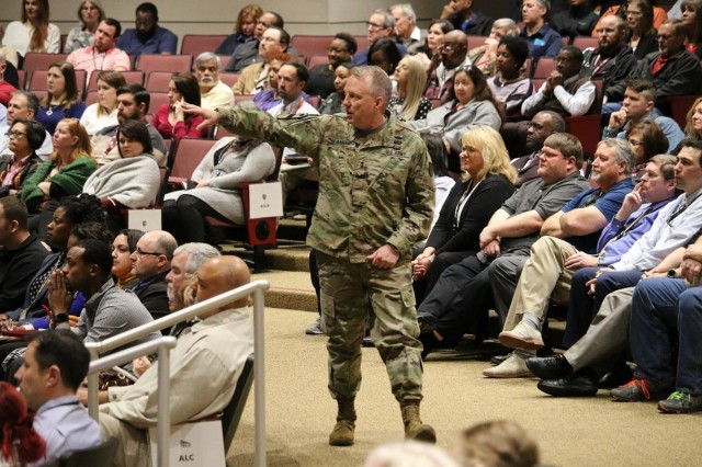 Maj. Gen. Doug Gabram, commander of the Aviation and Missile Command, speaks to AMCOM employees during his last town hall meeting, Feb. 11. Gabram relinquished command Thursday. He assumed his new position yesterday as director for test at the Missile Defense Agency.