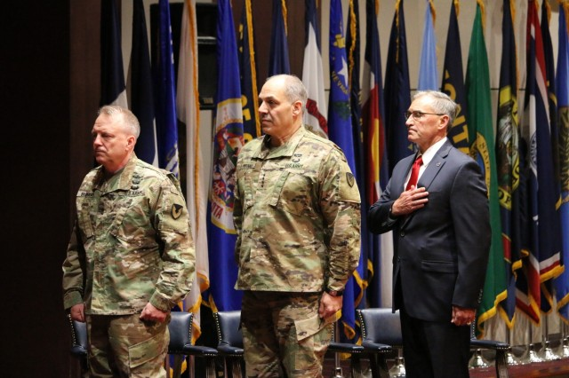 Maj. Gen. Doug Gabram (left), commander of  the U.S. Army Aviation and Missile Command, Gen. Gus Perna, commander of the Army Materiel Command, and William Marriott, AMCOM deputy to the commanding general, render honors during the playing of the National Anthem. Gabram relinquished command during a ceremony, Thursday. Marriott will serve as the AMCOM Executive Director until the new commander reports. Gabram assumed his duties as the Director of Test at the Missile Defense Agency, Tuesday.