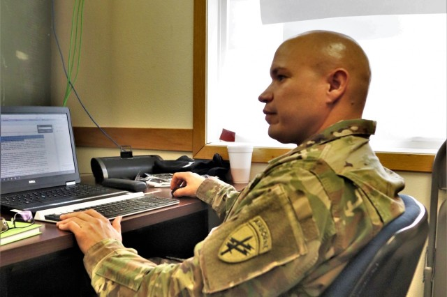 Master Sgt. Omar Cruz, battalion operations sergeant with the Army Reserve's 432nd Civil Affairs Battalion of Green Bay, Wis., works on a training document Feb. 8, 2019, at Fort McCoy, Wis., during Command Post Exercise-Functional 19-10. Approximately 300 Soldiers with civil affairs, psychological operations, and information operations units trained in the U.S. Army Civil Affairs and Psychological Operations Command- centric exercise that was conducted on post from Jan. 22 to Feb. 11. (U.S. Army Photo by Scott T. Sturkol, Public Affairs Office, Fort McCoy, Wis.)