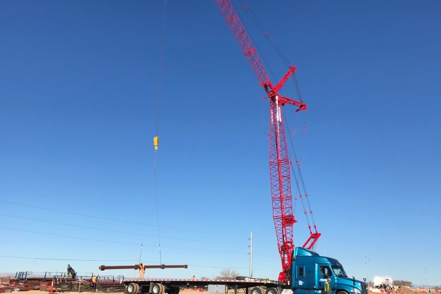 ALBUQUERQUE, N.M. -- Steel girders are unloaded by crane at the NNSA Albuquerque Complex site, Dec. 19, 2018.