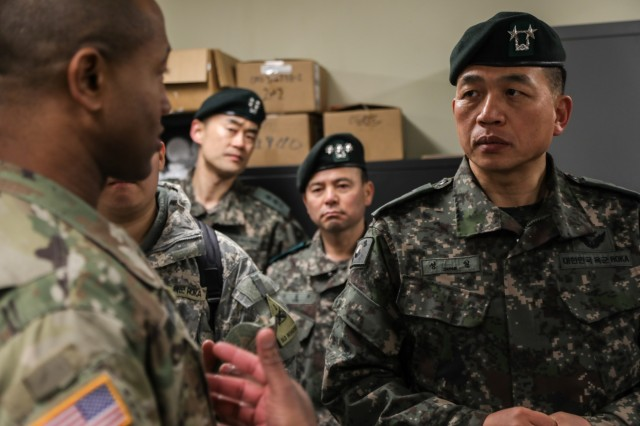 "CAMP HUMPHREYS, Republic of Korea - Lt. Col. Charles Montgomery, commander of 123rd Brigade Support Battalion ""Iron Support,"" 3rd Armored Brigade Combat Team ""Bulldog,"" 1st Armored Division, discusses Bulldog Brigade's combined sustainment operations with Maj. Gen. Sung, Il, deputy chief of staff, G4, for the ROK Army during a guided tour of Iron Supports areas of operation., Feb. 8. (U.S. Army photo by Sgt. Alon J. Humphrey, 3rd ABCT, 1st AD Public Affairs)"