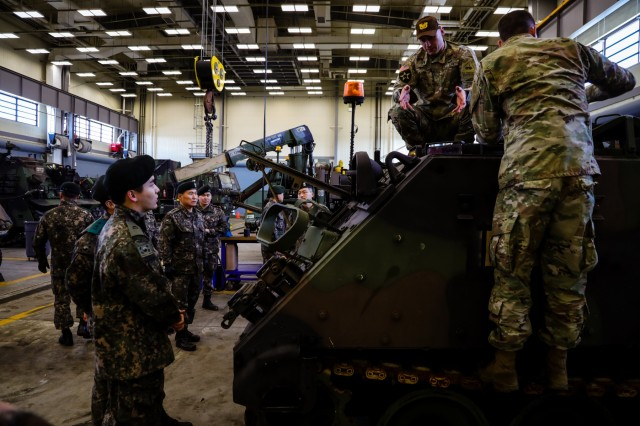 "CAMP HUMPHREYS, Republic of Korea - Soldiers from the 123rd Brigade Support Battalion ""Iron Support,"" 3rd Armored Brigade Combat Team ""Bulldog,"" 1st Armored Division provide a maintenance overview to  Maj. Gen. Sung, Il, deputy chief of staff, G4, for the ROK Army during a guided tour facilitated by Iron Support Battalion to showcase Bulldog Brigade's combined sustainment operations, Feb. 8. (U.S. Army photo by Sgt. Alon J. Humphrey, 3rd ABCT, 1st AD Public Affairs)"