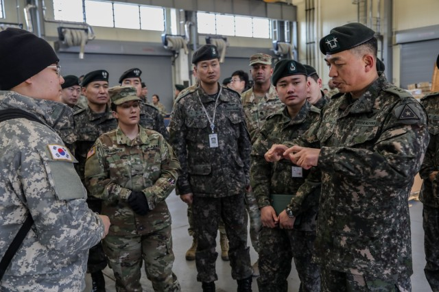 "CAMP HUMPHREYS, Republic of Korea -- Maj. Gen. Sung, Il, deputy chief of staff, G4, for the ROK Army provides insight to U.S. and ROK Army leaders during the 123rd Brigade Support Battalion ""Iron Support,"" 3rd Armored Brigade Combat Team ""Bulldog,"" 1st Armored Division led tour of Bulldog Brigade combined sustainment facilities, Feb. 8.  (U.S. Army photo by Sgt. Alon J. Humphrey, 3rd ABCT, 1st AD Public Affairs)"