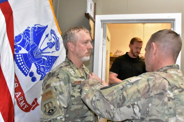 Department of Defense Expeditionary Civilian (DOD-EC) Ben Gibson was awarded the NATO Medal, Global War on Terrorism Medal, a Certificate of Wartime Service and a Certificate of Appreciation for his service to the Area Support Group-Afghanistan (ASG-A). The awards were presented by ASG-A Commander Col. Jacob Peterson at Bagram Airfield (BAF) Feb. 09, 2019.