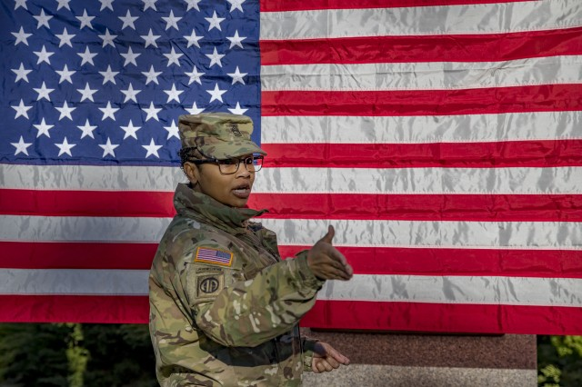 ZAGAN, Poland (Feb. 16, 2019) --  Master Sgt. Shantel Moneke Johnson, senior career counselor for 1st Armored Brigade Combat Team, 1st Infantry Division, prepares a location for the reenlistment of Spc. Jeb Stuart Dickey, commanders driver and motor transport operator, Headquarters and Headquarters Company, 1ABCT 1ID, Feb. 16. Johnson, who started her career in avionics, has enjoyed the last 11 years as a career counselor in the Army. (U.S. Army photo by Sgt. Thomas Mort)