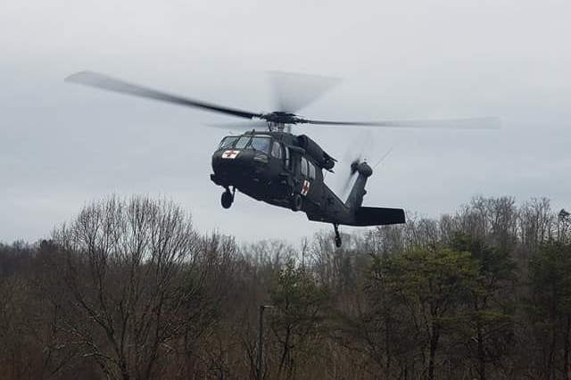 A West Virginia Army National Guard HH-60 Black Hawk assigned to Company C., 2-104th General Support Aviation Battalion (GASB), prepares to land in the parking lot of Ritchie County High School in Ellenboro, W.Va., following a successful aerial rescue mission for a stranded motorist Feb. 20, 2019. The state mission of the 2-104th GASB, located in Williamstown, W.Va., is to provide aeromedical evacuation and search and rescue capability to the Governor and the citizens of West Virginia in times of emergency.