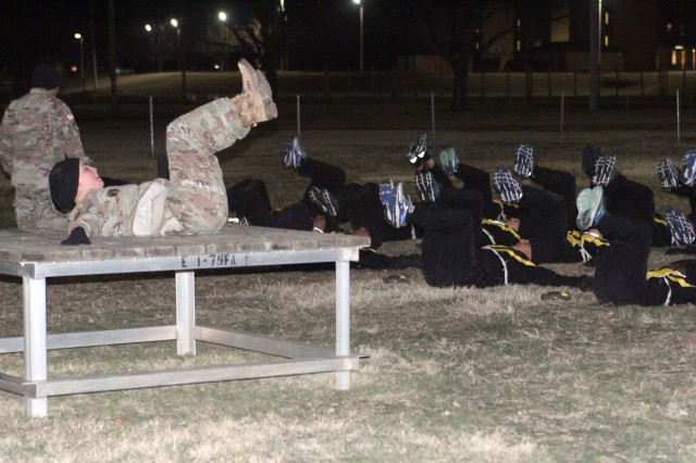 Senior Drill Sgt. (Staff Sgt.) Carolyn Jones leads a platoon of basic trainees from C Battery, 1st Battalion, 19th Field Artillery in a conditioning drill and warm-up at Fort Sill, Okla., Feb. 18, 2019. Battalion Soldiers went to perform the new Army Combat Fitness Test that their battalion is piloting for the 434th Field Artillery Brigade.