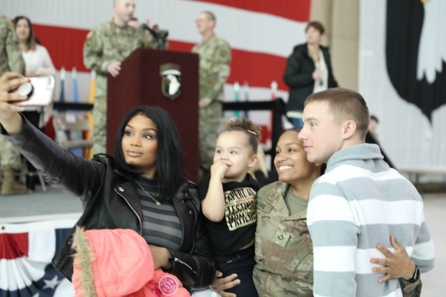 FORT CAMPBELL, Kentucky - Family members and friends greet 101st Sustainment Brigade, 101st Airborne Division (Air Assault) Soldiers as they return home following a nine-month deployment to Afghanistan, Feb. 21. (U.S. Army photo by Sgt. 1st Class Carlos Davis, 101st Sust. Bde. Public Affairs).