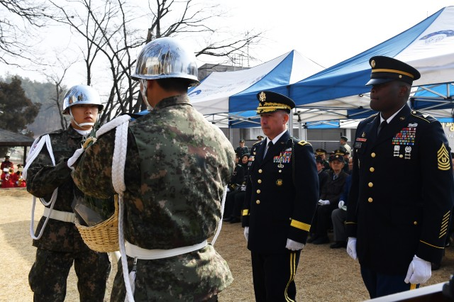 CHIPYONG-NI, Republic of Korea -- Brig. Gen. Stephen J. Maranian, (left) deputy commanding general-maneuver, 2nd Infantry Division/ROK-U.S. Combined Division and Boston, Massachusetts native, and Command Sgt. Major Michael Oliver, senior enlisted adviser, 3rd Armored Brigade Combat Team, 1st Armored Division (Rotational) and Detroit, Michigan native, prepare to render honors as a ceremonial wreath is placed during the 68th anniversary of the Battle of Chipyong-ni at the Chipyong-ni Combat Monument and Memorial Hall, Feb. 21. Nearly 70 years later many Soldiers, past and present, came together to highlight a battle where service members of different nationalities fought together to defeat a mutual enemy. (U.S. Army Photo by Pak, Chin U., 2ID/RUCD Public Affairs)