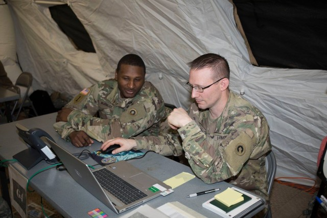 Soldiers from the 1st Theater Sustainment Command use the tactical network during an Early Entry Command Post (EE CP) training exercise supported by the 50th Expeditionary Signal Battalion-Enhanced (ESB-E), on February 18, 2019 at Fort Campbell, Kentucky.
