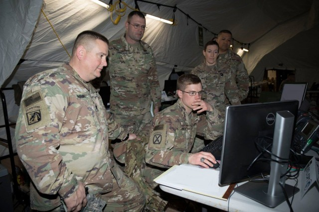 U.S. Soldiers leverage the tactical internet during a command visit during the 1st Theater Sustainment Command's (TSC) Early Entry Command Post (EE CP) training exercise in February 18, 2019 at Fort Campbell, Kentucky. The exercise was supported by the 50th Expeditionary Signal Battalion--Enhanced (ESB-E), which the Army fielded with a new more agile and mobile prototype tactical network equipment package.