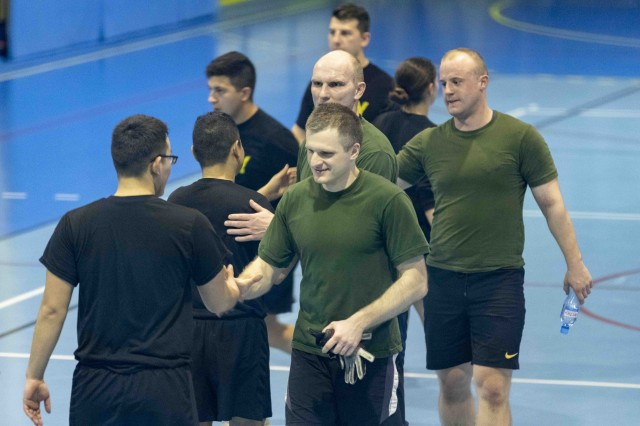 SKWIERZYNA, Poland (Feb. 21, 2019) -- U.S. Army Soldiers from 101st Brigade Support Battalion, 1st Armored Brigade Combat Team, 1st Infantry Division and Polish soldiers shake hands and congratulate each other after a hard fought game, here, Feb. 21. The American and Polish soldiers came together for a friendly futsal game, a variation of standard outdoor soccer, played on a hard court and typically indoors. (U.S. Army photo by Sgt. Thomas Mort)
