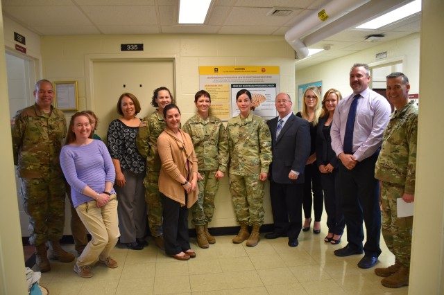 Maj. Gen. Barbara R. Holcomb (center), U.S. Army Medical Research and Materiel Command and Fort Detrick commanding general, visits with team members of the Neurotrauma and Psychological Health Project Management Office and Col. Ryan Bailey (right), USAMMDA commander, at the U.S. Army Medical Materiel Development Activity, Fort Detrick, Maryland.