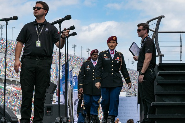 The 82nd Airborne Division Chorus marches on stage to perform for the 61st Annual Daytona 500 crowd before the start of the season-opener at the Daytona International Speedway in Fla., Feb. 17, 2019. The All American Chorus has performed across the world since 1967, spreading Paratrooper honor and pride through music.