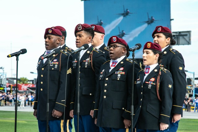 "The 82nd Airborne Division Chorus sings the ""National Anthem"" for the 61st Annual Daytona 500 at Daytona International Speedway in Fla., Feb. 17, 2019. The All-American Chorus has performed for over 50 years, spreading pride and patriotic cheer through their performances."