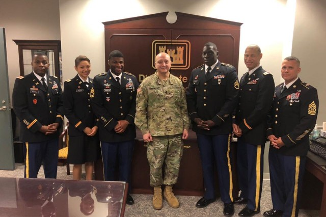 Maj. ChaTom Warren, 1st Lt. Liz Moton, Chief Warrant Officer 3 Janson McDowell, Sgt. 1st Class Demarcus Barrow and Staff Sgt. Henry Williams accept the BEYA awards with Maj. Gen Anthony Funkhouser, Deputy Commanding General for Military an International Operations, U.S. Army Corps of Engineers. Command Sgt. Maj. Chad Blansett, 130th Engineer Brigade's senior enlisted advisor also attended, lending support to recipients