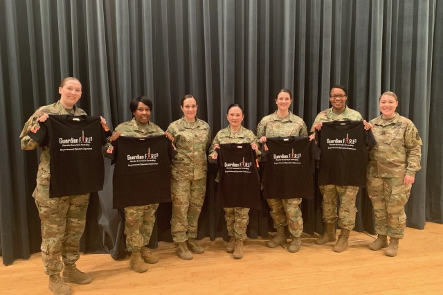 FIRE3 leads, Capt. Gabriel Bull and Sfc. Shari Stewart, present the panel with FIRE3 t-shirt as a token of appreciation.