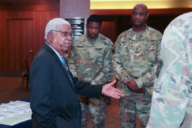 FORT BENNING, Ga -- Retired Sgt. 1st Class Melvin Morris, who earned a Medal of Honor for his valor during the Vietnam War and is one of the first African-American Green Berets, talks to Soldiers Feb. 22 during a Black History Month observance at the National Infantry Museum. (U.S. Army photo by Markeith Horace, Maneuver Center of Excellence, Fort Benning Public Affairs)