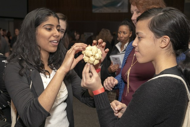Nithya Nalluri (left) and Stephanie Andrade, students of Hunterdon Central Regional High School, examine the intricate mechanics of 3D printing during an Introduce a Girl to Engineering event at Picatinny Arsenal, N.J., Feb. 21.