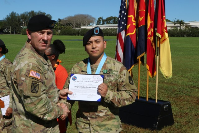 Command Sgt. Maj. Brian A. Hester, 25th Infantry Division Command Sergeant Major (left), presents Staff. Sgt. Paul Navarrete (right) with a certificate during the Sergeant Audie Murphy Club induction ceremony on February 20, 2019 at Schofield Barracks, Hawaii. The Sergeant Audie Murphy Club is for U.S. Army non-commissioned officers whose leadership and performance may earn them membership in this prestigious club.