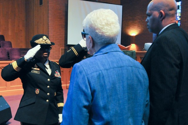 Marla L. Andrews (center), daughter of U.S. Army Air Forces Capt. Lawrence E. Dickson, receives her father's medals from Brig. Gen. Twanda E. Young, deputy commanding general of the U.S. Army's Human Resources Command, during a Feb. 24 ceremony held at Fountain Baptist Church in Summit, N.J. Dickson was a Tuskegee Airman declared missing in action after his plane crashed in Europe in Dec. 1944. Dickson's remains were identified in Nov. 2018 using the latest DNA tests, making him the first to be identified out of more than two-dozen Tuskegee Airmen declared MIA during World War II.