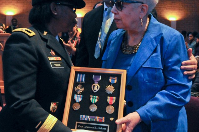 Marla L. Andrews (right), daughter of U.S. Army Air Forces Capt. Lawrence E. Dickson, receives her father's medals from Brig. Gen. Twanda E. Young, deputy commanding general of the U.S. Army's Human Resources Command, during a Feb. 24 ceremony held at Fountain Baptist Church in Summit, N.J. Dickson was a Tuskegee Airman declared missing in action after his plane crashed in Europe in Dec. 1944. Dickson's remains were identified in Nov. 2018 using the latest DNA tests, making him the first to be identified out of more than two-dozen Tuskegee Airmen declared MIA during World War II.