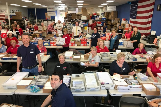 For the Troops volunteers who put together and package the care boxes military members and civilians receive while deployed in Afghanistan and Iraq.