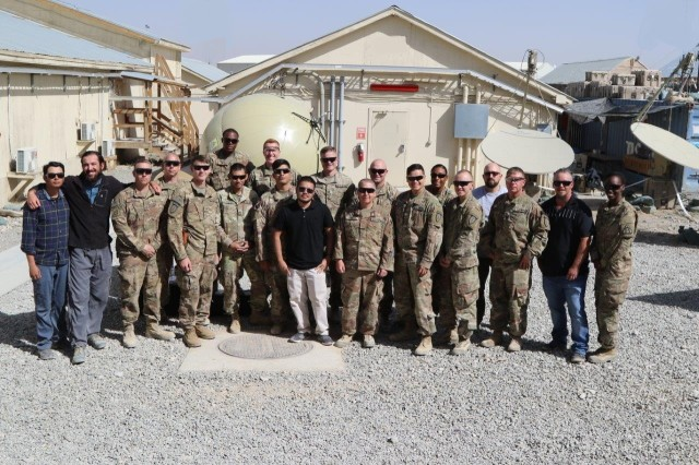 """The PM for Tactical Network provided new equipment training and fielding on SCOUT satellite terminals to the 1st SFAB in Afghanistan in September 2018. At far right is Capt. Domoniqué Hittner, assistant product manager for Satellite Communications, who observed that it was important to conduct thorough site visits to see what assets were available. """"You don't know what you don't know until you are there on the ground,"""" she said."""