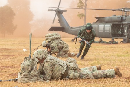 A Royal Thai Army soldier moves to pull security with his U.S. counterparts during an air assault training mission, Feb. 5, 2019, at Sa Kaeo Province, Thailand, as part of Hanuman Guardian. Exercise Hanuman Guardian provides a venue for both the U.S. and Thailand armies to advance interoperability and increase partner capacity by planning and executing complex combined task force operations.
