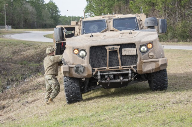 The Joint Light Tactical Vehicle is equipped with an electronic adjustable height suspension, which can lower and raise the vehicle from 8 to 30 inches from its exhaust to the ground. It can also lower one end of the vehicle to keep it level on uneven terrain like pictured here.