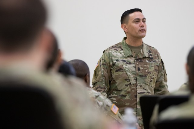 Command Sgt. Maj. Osvaldo J. Martinez, regimental command sergeant major of the U.S. Army Judge Advocate General Corps, gives a brief to paralegals and civilians at the U.S. Army Reserve Legal Command South Eastern Region On-Site Legal Training (OSLT) at Fort Benning, GA, Feb. 22. This OSLT marks the first Army legal training event where Army, Army Reserve, and National Guard judge advocates and paralegals are conducting training together (U.S. Army Reserve photo by Maj. Jeku Arce, U.S. Army Reserve Legal Command).