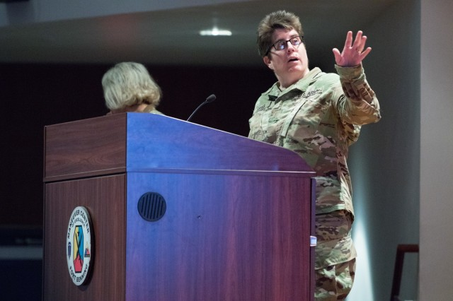 Chief Warrant Officer 5 Kristi Estes, senior legal administrator at the U.S. Army Office of the Judge Advocate General, gives a brief on the active duty-reserve component total readiness at the U.S. Army Reserve Legal Command South Eastern Region On-Site Legal Training (OSLT) at Fort Benning, GA, Feb. 22. This OSLT marks the first Army legal training event where Army, Army Reserve, and National Guard judge advocates and paralegals are conducting training together (U.S. Army Reserve photo by Maj. Jeku Arce, U.S. Army Reserve Legal Command).