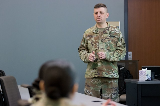 Chief Warrant Officer 4 James (Jim) Carroll, chair of the The Judge Advocate General's Legal Center and School's legal administrator and paralegal studies department, gives a brief on leadership at the U.S. Army Reserve Legal Command South Eastern Region On-Site Legal Training (OSLT) at Fort Benning, GA, Feb. 22. This OSLT marks the first Army legal training event where Army, Army Reserve, and National Guard judge advocates and paralegals are conducting training together (U.S. Army Reserve photo by Maj. Jeku Arce, U.S. Army Reserve Legal Command).