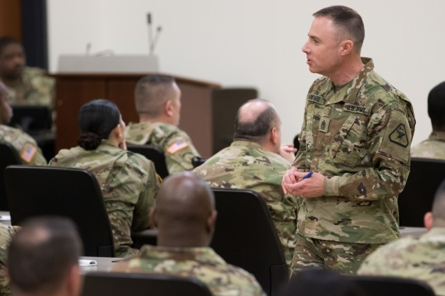 Sgt. Maj. Stephen Minyard, U.S. Army Reserve Legal Command (USARLC) senior enlisted leader of operations, gives a brief to paralegals and civilians at the USARLC South Eastern Region On-Site Legal Training (OSLT) at Fort Benning, GA, Feb. 22. This OSLT marks the first Army legal training event where Army, Army Reserve, and National Guard judge advocates and paralegals are conducting training together (U.S. Army Reserve photo by Maj. Jeku Arce, U.S. Army Reserve Legal Command).