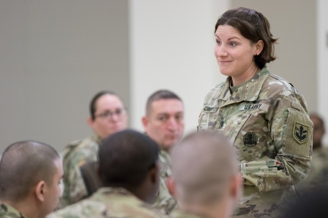 1st Sgt. Charlene Crisp, the Judge Advocate General's Legal Center and School deputy commandant, gives a brief to paralegals at the U.S. Army Reserve Legal Command South Eastern Region On-Site Legal Training (OSLT) at Fort Benning, GA, Feb. 22. This OSLT marks the first Army legal training event where Army, Army Reserve, and National Guard judge advocates and paralegals are conducting training together (U.S. Army Reserve photo by Maj. Jeku Arce, U.S. Army Reserve Legal Command).