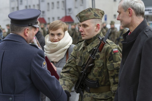 SKWIERZYNA, Poland (Feb. 23, 2019) — A Polish military cadet is congratulated as one of the top four graduates, during a ceremony in support of 61 Polish cadets taking an oath to defend and serve their country, in the town center, Feb. 23.