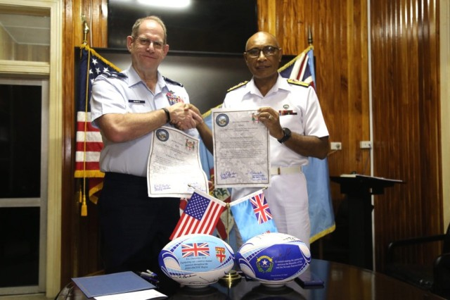 Brigadier General William R. Burks, Adjutant General for the State of Nevada (left) with Rear Admiral Viliame Naupoto, Commander of the Republic of Fiji Military Forces enter the island country into the State's Partnership Program.