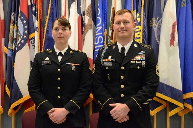 Spc. Esther Alger and Sgt. 1st Class Paul Bosserman, both assigned to the Fort Belvoir-based Headquarters Battalion, 29th Infantry Division, are announced as winners of the 2019 Virginia National Guard Best Warrior Competition Feb. 24, 2019, at Fort Pickett, Virginia. Alger was named Soldier of the Year and Bosserman was named NCO of the Year after three mentally and physically grueling days of competition against Soldiers and NCOs from six different VNG major subordinate commands. (U.S. National Guard photo by A.J. Coyne)