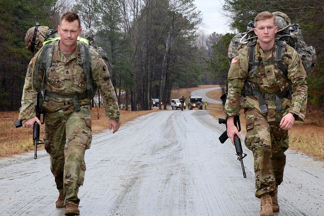 Sgt. 1st Class Paul Bosserman (left), the 2019 Virginia National Guard NCO of the Year, and Sgt. Devin Piotrowski (right), the runner up for NCO of the Year, participate in the 8-mile ruck march at the 2019 Virginia National Guard Best Warrior Competition Feb. 22, 2019, at Fort Pickett, Virginia. (U.S. National Guard photo by Mike Vrabel)