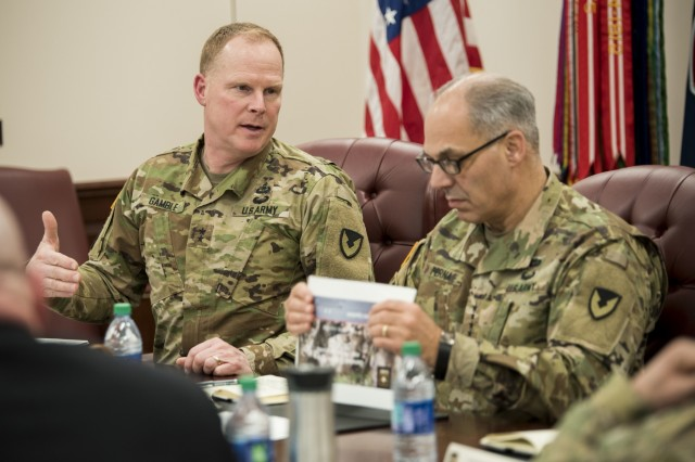 Maj. Gen. Duane Gamble, commanding general, U.S. Army Sustainment Command, leads a quarterly update meeting with Gen. Gus. Perna, commanding general, U.S. Army Materiel Command at Rock Island Arsenal, Ill., Feb. 26.