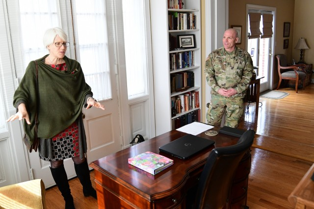 "Major Gen. Frank Muth, commanding general of U.S. Army Recruiting Command, listens as Helen Patton, granddaughter of legendary tank commander Gen. George S. Patton Jr., as she describes what his quarters looked like in the 1970s when she lived there as a young girl. Helen stopped by Fort Knox, Ky., Feb. 26, 2019, as part of a trip to the United States to coordinate the second annual ""Game That Never Happened"" football game that is set to be played again in Bastogne, Belgium later this year."