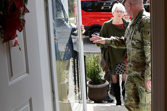 Major Gen. Frank Muth, commander of U.S. Army Recruiting Command at Fort Knox, Ky., invites Helen Patton into his home for a tour Feb. 26, 2019. She, along with others in her group, arrived to remember her time at the post when she was 9-11 years old. At that time, her father, then Brig. Gen. George S. Patton III, was commander of the U.S. Army Armor School and deputy commander of the post.