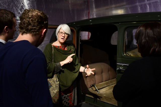 Helen Patton explains to Hans Van Kessell and his two sons Feb. 26, 2019, where her grandfather Gen. George Patton Jr. was sitting when his military vehicle crashed in Germany shortly after the end of World War II, resulting in his eventual death. The General George Patton Museum at Fort Knox, Ky., is home to the vehicle, along with several other artifacts of the legendary tank general.