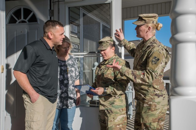 Capt. Heather Weaver, Combat Training Company commander, and 1st Sgt. Polly Schmidt, CTC, far right, visit the home of Sgt. 1st Class Christopher Parker and his wife, Lisa, as part of an ongoing Army-wide effort to resolve unsatisfactory conditions in family housing on installations.